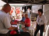 Ago signs autographs with Eraldo Ferraci and Vicki Smith attending to the orderly crowd