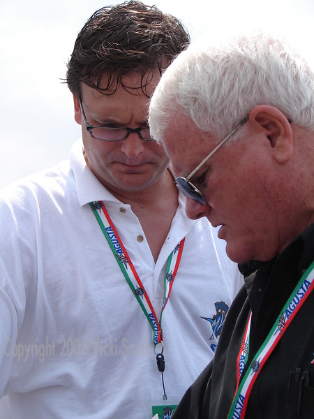 Larry and Eraldo Ferracci share a moment in pit lane