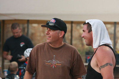 Billy Janniro (R) and Bobby Hedden retired veteran Fast Friday's rider enjoy a light moment in the pits.