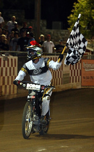 Charlie celebrates his first handicap main event win of the season with a victory lap.
