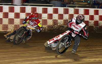 Billy Janniro (L) and Kelly Kerrigan (R) face off in a handicap heat race.  Both riders are sponsored by Red Line Oil and both picked up wins, Janniro in the scratch main and Kerrigan in the handicap main.