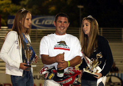 Billy Janniro celebrates with Fast Friday's trophy girls.
