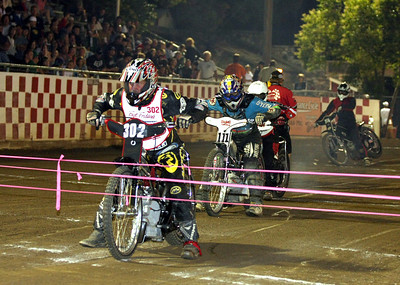 Fast Friday's promoter David Joiner joins in on the fun as he rides in the Division III Main Event.