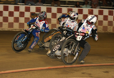 (L-R) Tommy Hedden, Bart Bast, and Kelly Kerrigan get close in a turn.