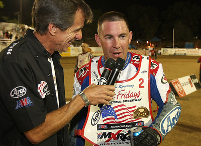 First round USA National Speedway Championship leader Billy Janniro has a talk with Fast Friday's track announcer Mike Rooney, after scoring 20 in the first round.