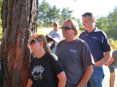 Paul & Ann-Marie hide behind a tree