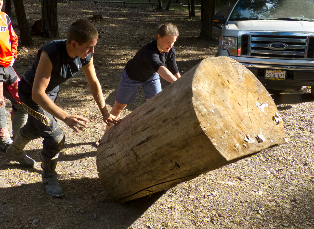 Becka concentrates hard in order to balance the log with mindpower alone.