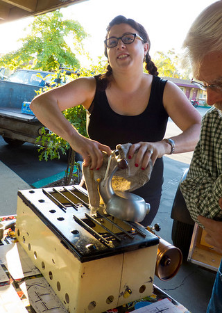 Organizer Deb Welch brews up a batch of atomic coffee to start the day.