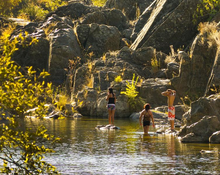 Kids swimming below the Highway 70 bridge.