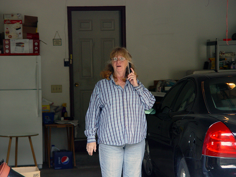 My Mom, very surprised to see me.  I told her I had sent her a package for Mother's Day, and had just gotten delivery confirmation.  ...while I had her on the phone, she went outside to look for it. :)