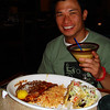 Stephen with his dinner and mango Margarita!