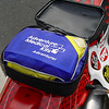 I carry tools in my pack, so I use the bag to hold my first aid kit.  I prefer to keep weight off the subframe as much as possible.
