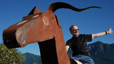 In Stevenson we came across a trailer with this metal cow sculpture on the top ... probably for a cheesy parade float. Nothing doing but I had to ride the cow.  Photo by my daughter Carolyn, We conspired on the editing.
