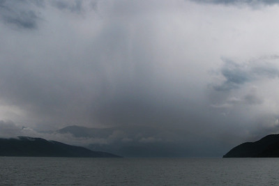 Kootenay Bay Ferry: View of our impending weather as we crossed the longest free ferry in North America.
