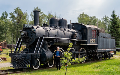 Prince George:  There's a neat BC Rail museum where we spent some time walking around and through some old trains. Very cool. Phantom stands in front of this vintage steam locomotive.