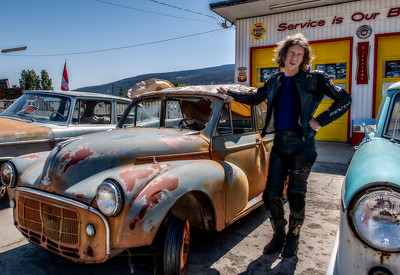 Between Lillooet and Quesnel, we stopped to stretch our legs and found this vintage auto dealer next to the convenience store. Stardog Champion poses next to his next project.