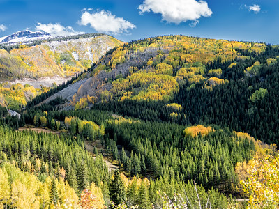NOAA weather calls for clear skies and overnight lows of 23 degrees on the million-dollar-highway. We delay our start lingering over breakfast until 10:00 when the thin sun is warming our route just enough to continue. We ride uphill over Coal Bank Pass, Molas Pass, and Red Mountain Pass (11,018 feet.) The Aspens are brilliant, the skies cerulean, with frozen snow on the shoulders and trees dusted white.