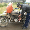 A helpful Ural rider donating some petrol.