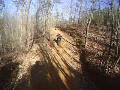 This is back to trail 1.  Sarah was really cooking here and even managed to get Rocker to pull over when he kept hearing that little pissed off KX100 behind him!  LOL.  <br /> <br /> This was definitely one of her fastest runs down Trail 1.