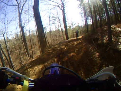 This is Trail #27 and I'm following Josh on the 09 TXC 250.  He stalls on a hill and I end up in front of him.