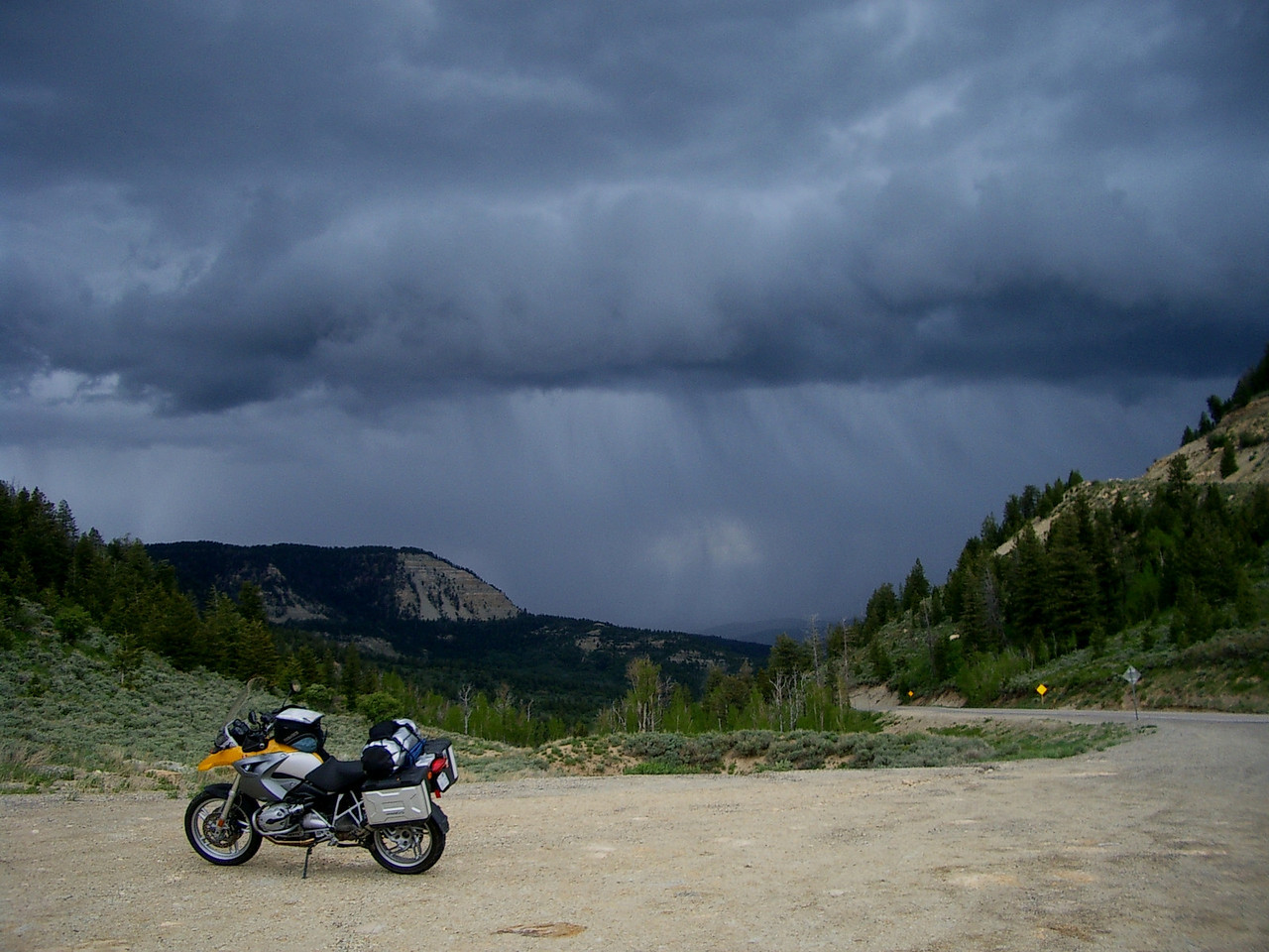 Damn, I'm headed straight into that storm! Not very inviting on a bike.<br /> <br /> Some other riders came through the same pass a few minutes after me, saw these clouds, and soon we were all changing into our rain gear together.