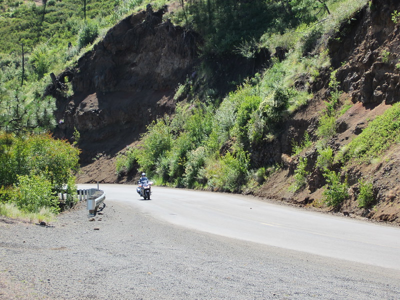 The road crosses the border into Oregon and OR3 climbs up and out of the canyon on another excellent stretch of road.  David approaching on his ST1300.