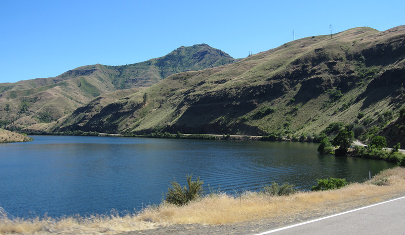 At the bottom of the hill, the road leads beside the Oxbow Reservoir on the Snake River.