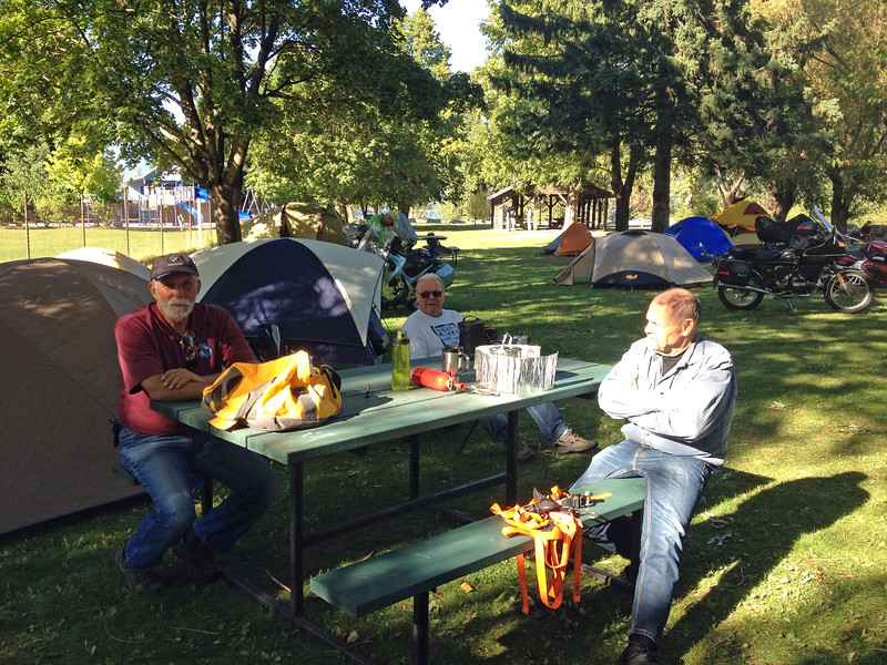 Meanwhile back at camp, Ron, Gary and Sandy are soaking up some more warmth.