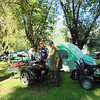 Martin admiring No-Camp-Jim's camping rig.  Jim can sure haul all the luxuries from home in the sidecar trailer combo.