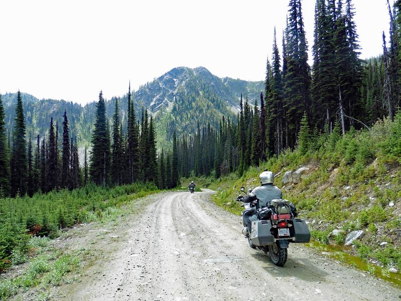 Doug and John heading down the eastern slope of Gray Creek Pass.