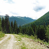 Gray Creek Pass Road follows Baker Creek Down the Eastern side.