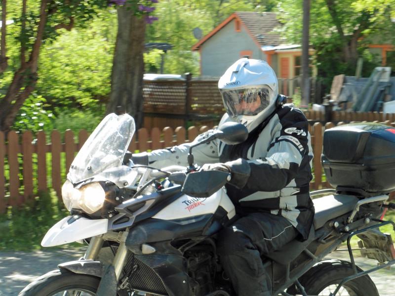 Sandy arriving on his Triumph Triple.