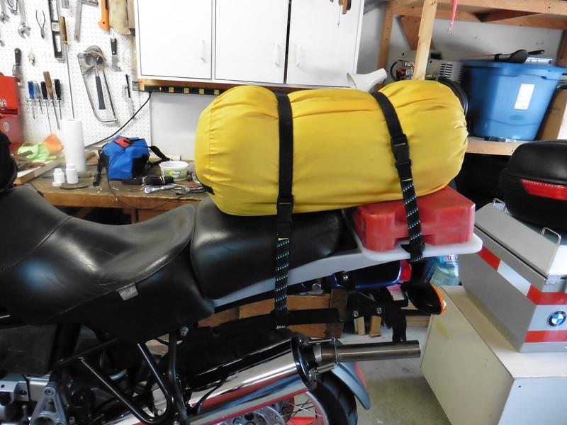 With the rear seat in place the fuel tank creates a flat platform for mounting a duffel bag of just about any size.