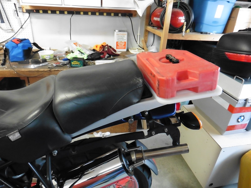 There are two holes drilled to mount a ROTO-Pax gas tank.  While the GS carries the same amount of fuel as my departed KLR it didn't have the same range.  The addition of an extra gallon should get me back up to target for trips through the back country.