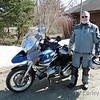 A beautiful day on March 30th.  I rode to Armstrong for some cheese, then stopped in to see Martin.  He obliged me in taking a photo in his driveway as I needed one for the web site.  Yes, that is snow in the background.