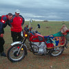 2 of the guy inspect the Russian made bike - note the saddle in the rear.