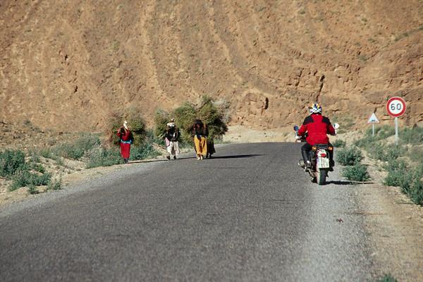 going wrong way we meet ladies carrying sticks