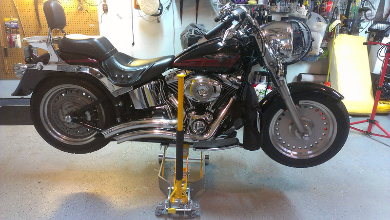 Fatboy floating ontop of a Craftsman Professional Motorcycle Jack