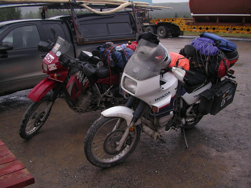 Simon's KLR and my TA meet one last time at a soggy lunch stop in Buckinghorse, British Columbia - CO2AK08