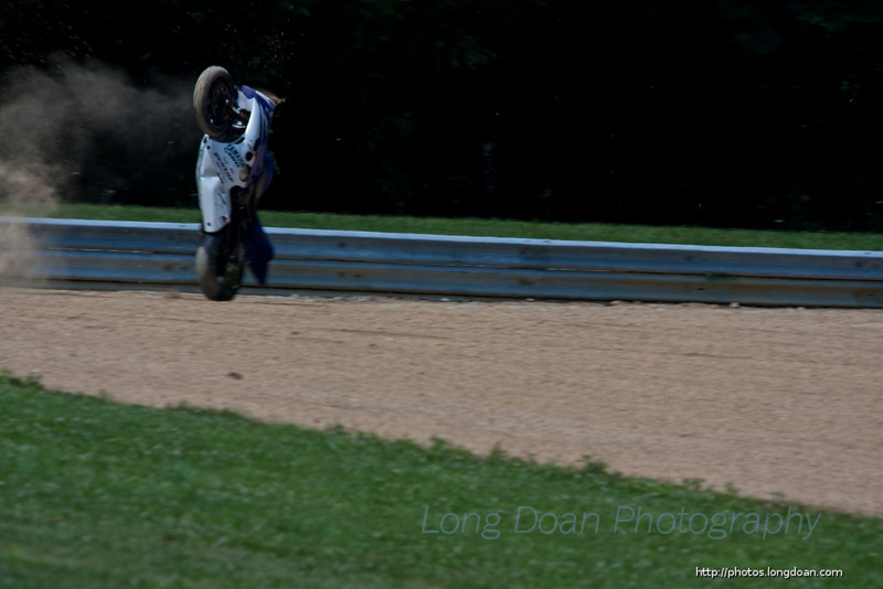 """Josh's bike tumbled through the air.<br /> <br /> More of that here:<br /> <a href=""""http://photos.longdoan.com/MotorcycleRaces/OnTheTrack/20100718-mid-ohio-oops/"""">http://photos.longdoan.com/MotorcycleRaces/OnTheTrack/20100718-mid-ohio-oops/</a>"""