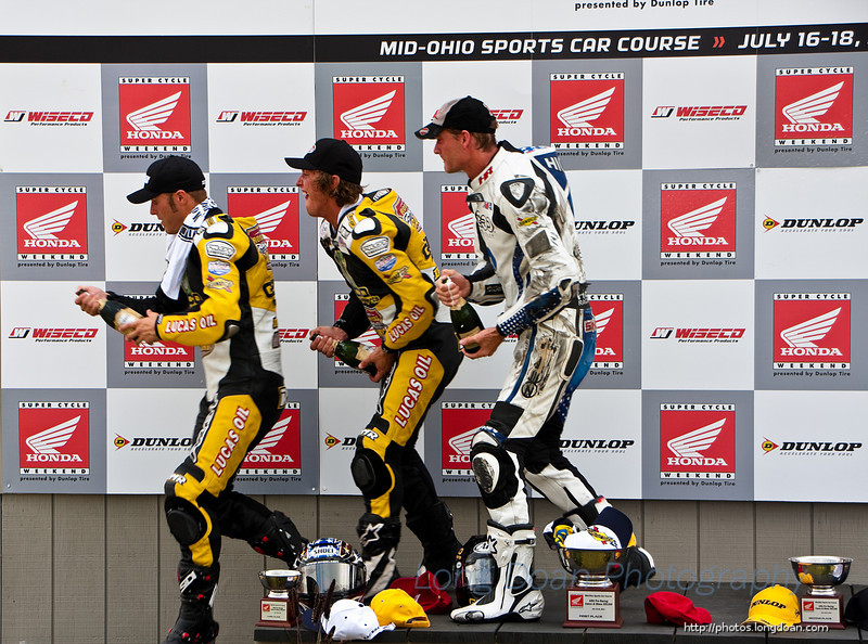 The winners about to spray champagne at the trophy ceremony for the XR1200 race.