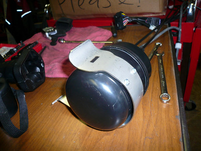 this series of photos shows how, we modified this switch/canister in order to put aftermarket shocks on the bike in the future.  this was not as MC cruise had instructed us to mounted in their instructions, but they did send photos similar to how were doing it that had been sent to them by someone else