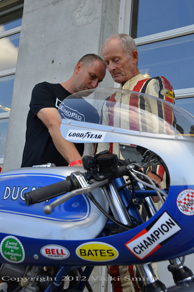 Rich Lambrechts and Cook Neilson wait for Cook to make his last track ride on Deja Blue