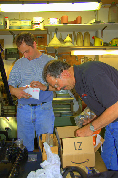 Jim and Rich Lambrechts in Rino Caracchi's NCR home workshop, building a little Motogiro Ducati 125 in three days, using Franco Farne's tools.