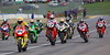 The AMA decided to grid the heat race finishers first and the DNS factory bikes after that.  This resulted in what was basically an inverted start. The first lap was a total scramble. Here Neil, Miguel Duhamel and Jake Zemke all head to the front.