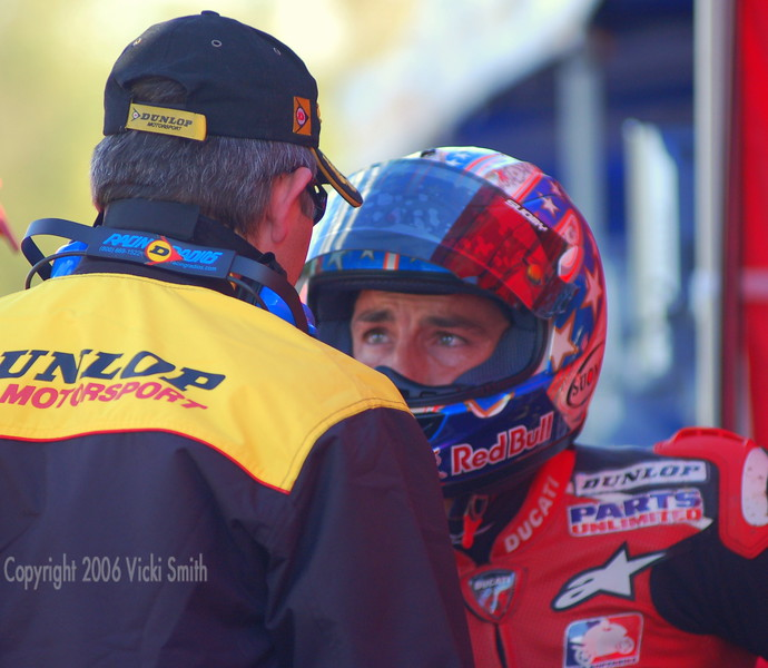 Tires are always the key. Here Ben shares feedback with the Dunlop engineer.