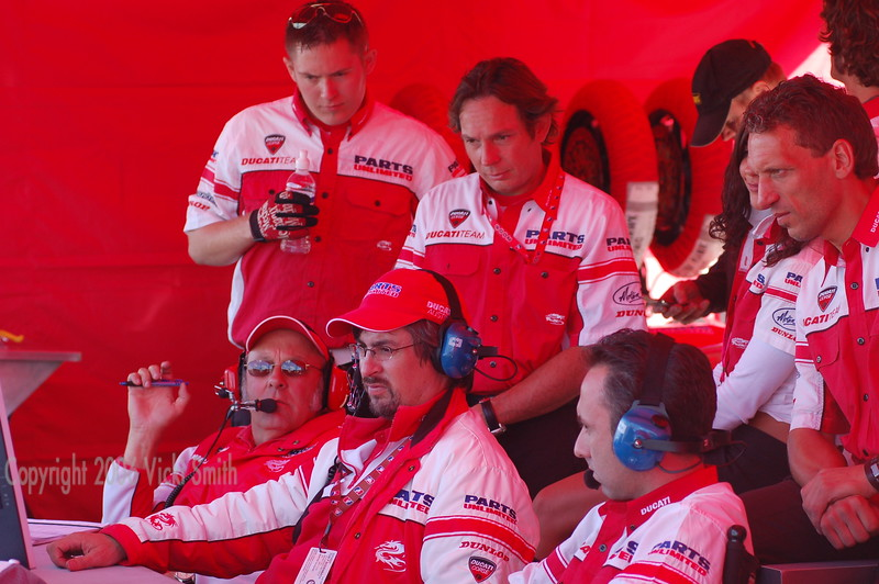 The crew are locked to the TV feed - the racing is close and Neil is at the front