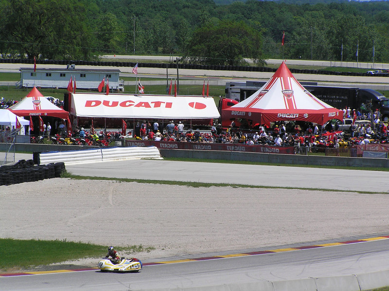 Seen from across the hill, it is clear that we need more space for next year.  BTW, those sidecars are a blast!