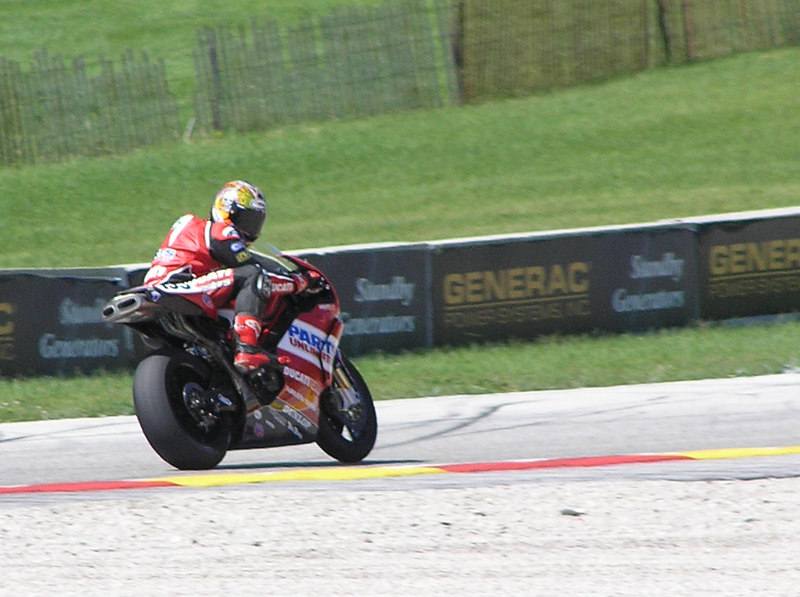Ben rounding Corvette corner, glancing back at the gathered Ducatisti!