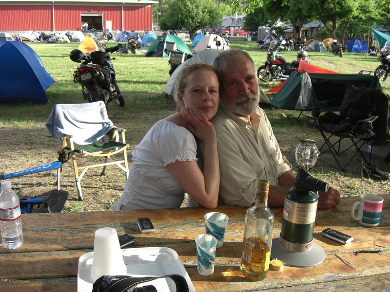 emily and dave (dave's tent cot, f650gs w/ trailer in the background)
